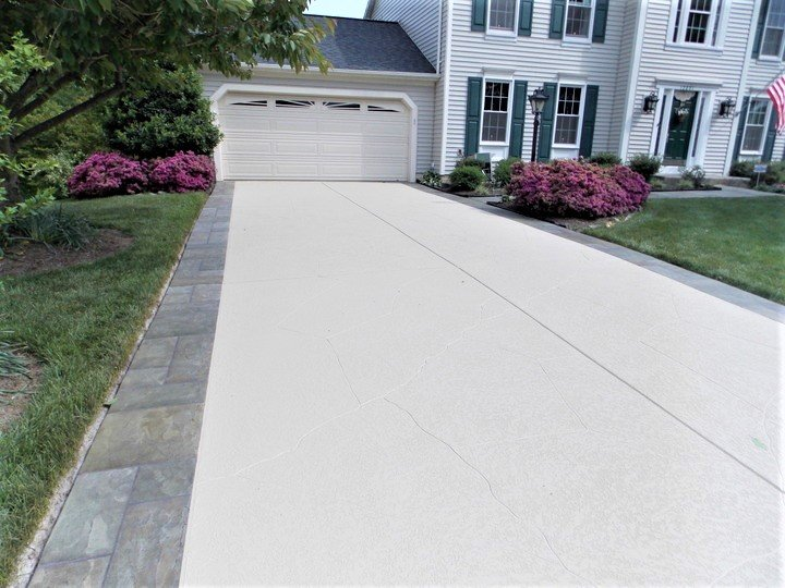 concrete driveway in front of house
