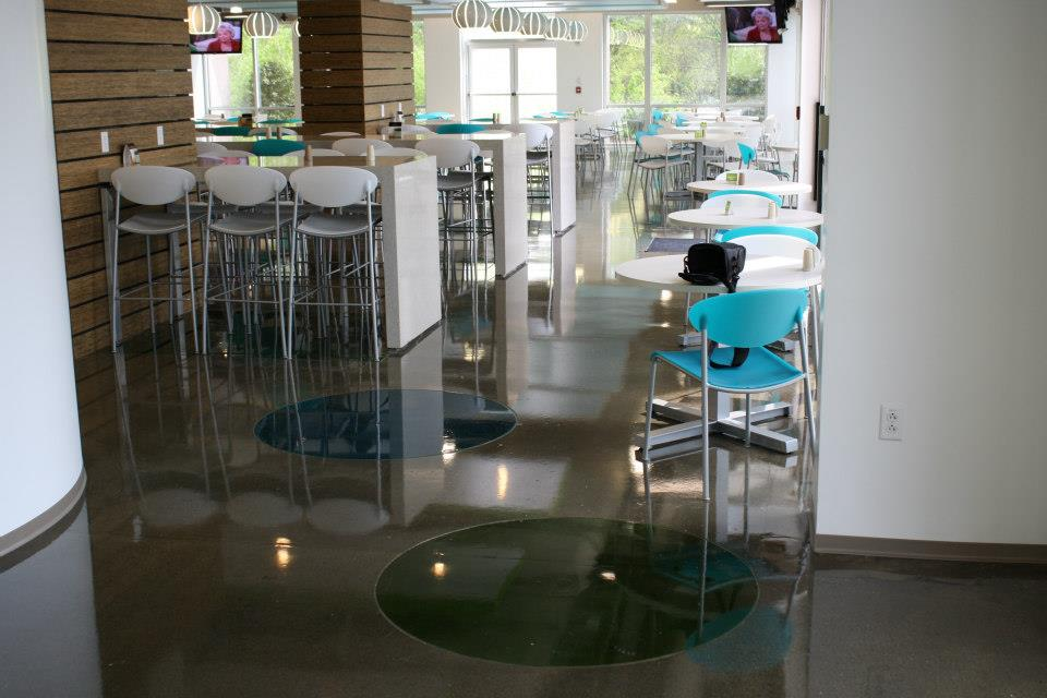 staining concrete floor in open restaurant